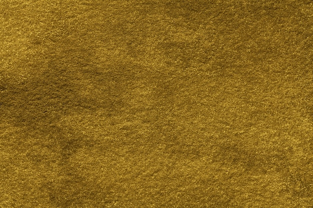 Goldene farbe des hintergrunds der abstrakten kunst. aquarellmalerei auf leinwand mit farbverlauf. textur des alten gelben papiers.