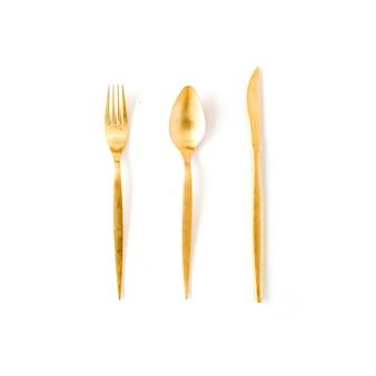 Goldene gabel, löffel, messer lokalisiert auf weiß