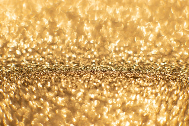 Goldene sand abstrakte bokeh lichter. defokussierter hintergrund