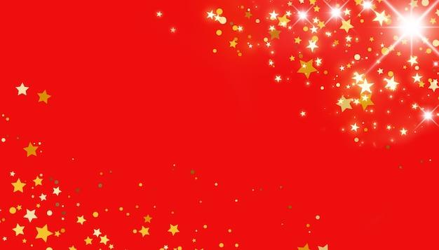 Goldene sterne auf rotem hintergrundweihnachtskonzept