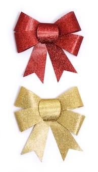Goldene und rote schleifen auf weiß