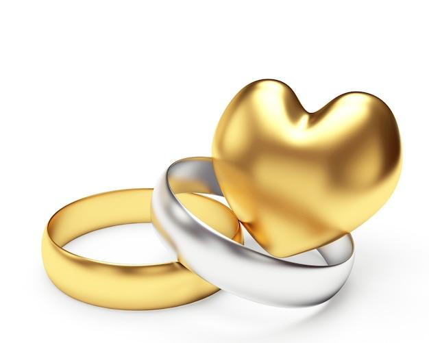 Goldene und silberne eheringe und herz