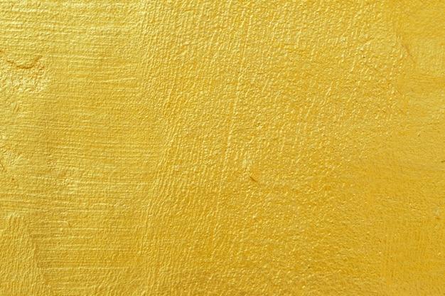 Goldene wandhintergrundbeschaffenheit