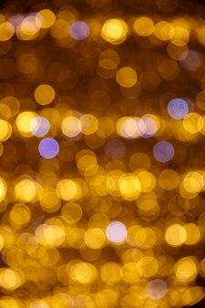 Goldener abstrakter bokeh-hintergrund. runde lichter.