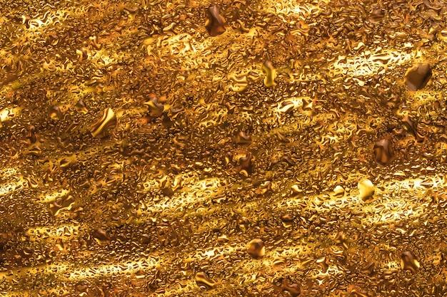 Goldener abstrakter hintergrund mit blasen. kreative tapetenbeschaffenheit, heller gelber moderner hintergrund. glänzende festliche glasige oberfläche, glitzerndes schillerndes glas.