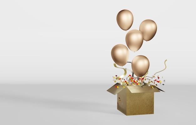 Goldener ballon mit schachtel öffnen sie eine pappschachtel und lassen sie einen ballon los, um den großen tag zu feiern