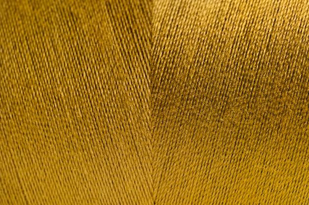 Goldener gerollter garnbeschaffenheitshintergrund