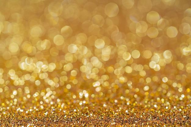 Goldener glänzender festlicher weihnachtshintergrund