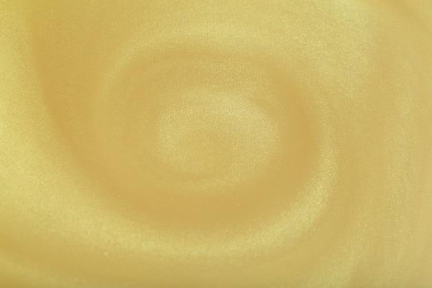 Goldener glitzer abstrakter hintergrund glamouröser goldener glitzernder magischer heller festlicher hintergrund für...