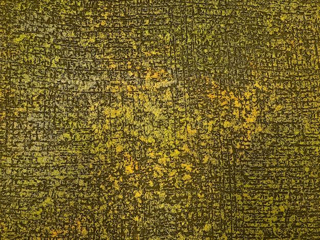 Goldener hintergrund des dekorativen betons. antiker farbiger beton