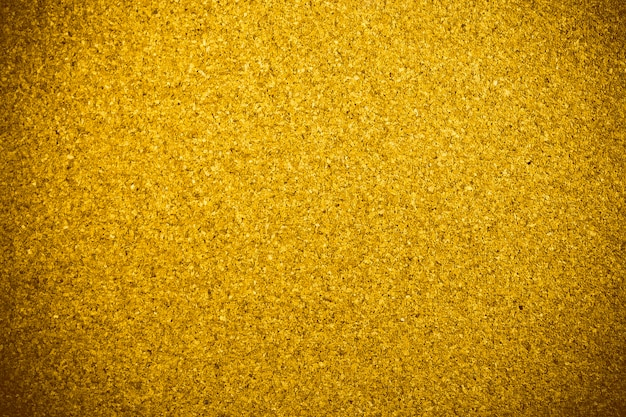 Goldener korkholzbeschaffenheitshintergrund.