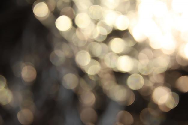 Goldener lichteffekt-hintergrund