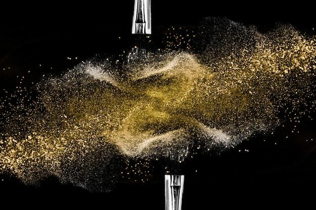Goldener pulverschwarzhintergrund