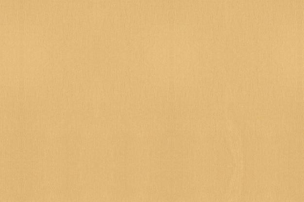 Goldener strukturierter papierhintergrund. reinigen sie strukturierten hintergrund