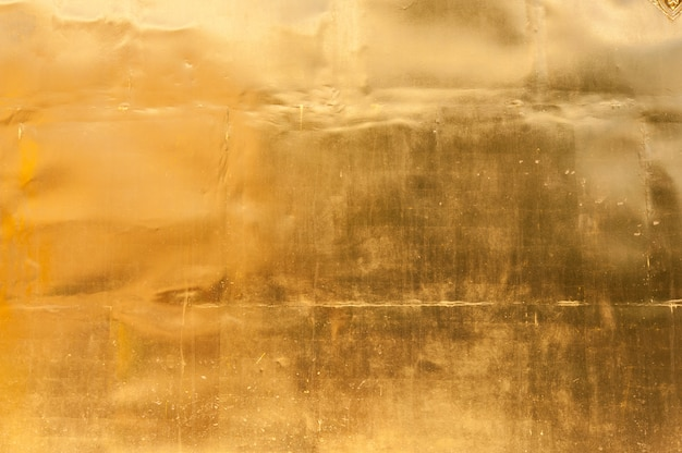 Goldener wandbeschaffenheitshintergrund