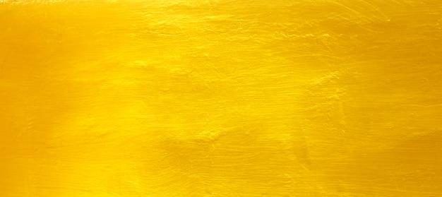 Goldener zementwandhintergrund