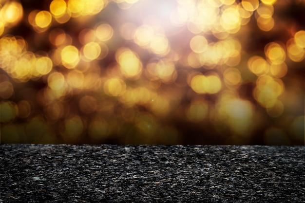 Goldenes bokeh beleuchtet produkthintergrund