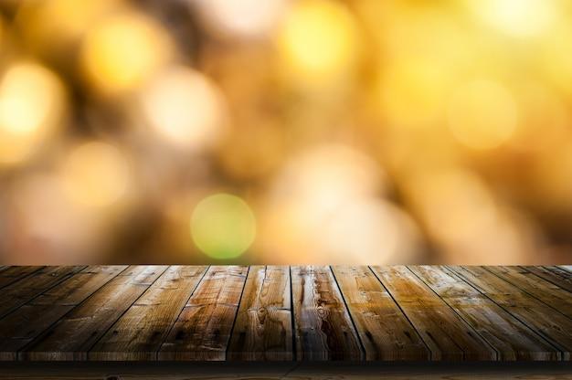 Goldenes bokeh mit tisch