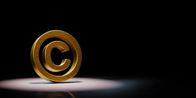 Goldenes copyright-symbol angestrahlt auf schwarzem hintergrund
