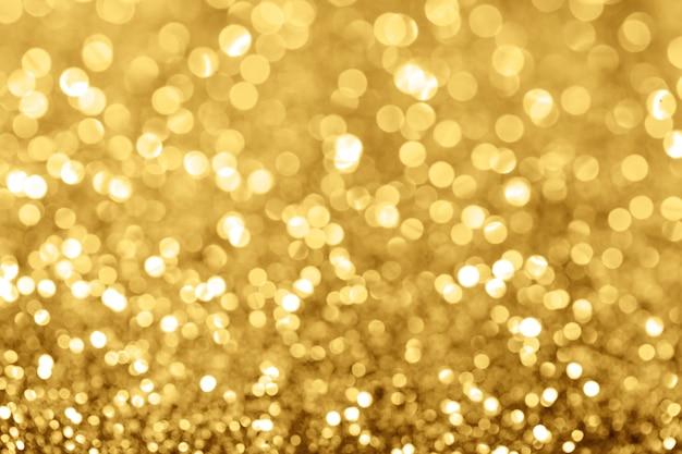 Goldenes feiertagshintergrund bokeh