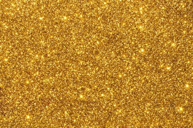 Goldenes funkeln für beschaffenheit oder hintergrund