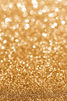 Goldenes funkeln. glitzerhintergrund.