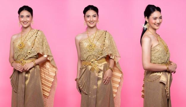 Goldenes kleid der thailändischen tracht oder südostasien-goldkleid in asiatischer frau mit dekorationsporträt in vielen posen unter studiobeleuchtung rosa süßer hintergrund, collage-gruppenpaket