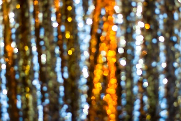 Goldenes silbernes glitzer-bokeh verwischte abstrakte hintergrundüberlagerung