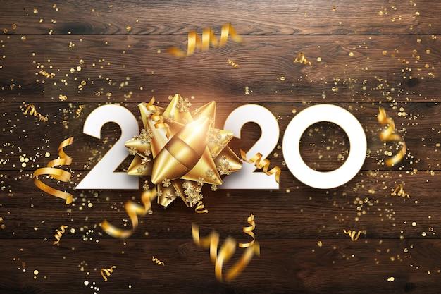 Goldenes zeichen des neuen jahres 2020 auf einem hölzernen hintergrund.
