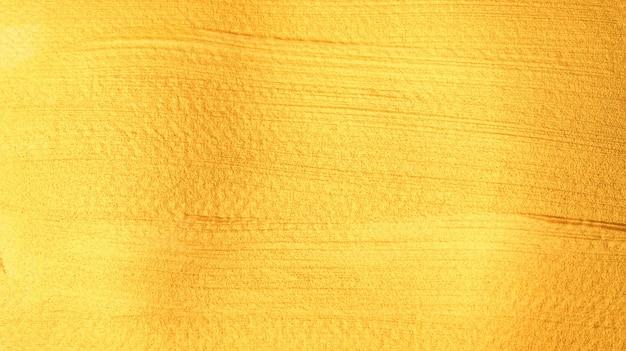 Goldfarbenes plakataquarell für einen abstrakten hintergrund.