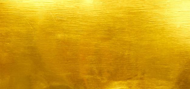 Goldfolienbeschaffenheitshintergrund