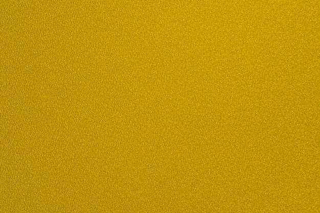 Goldgelbes papierblatt hintergrundschimmer textur