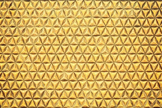 Goldgeometrischer beschaffenheitsmetallwandhintergrund