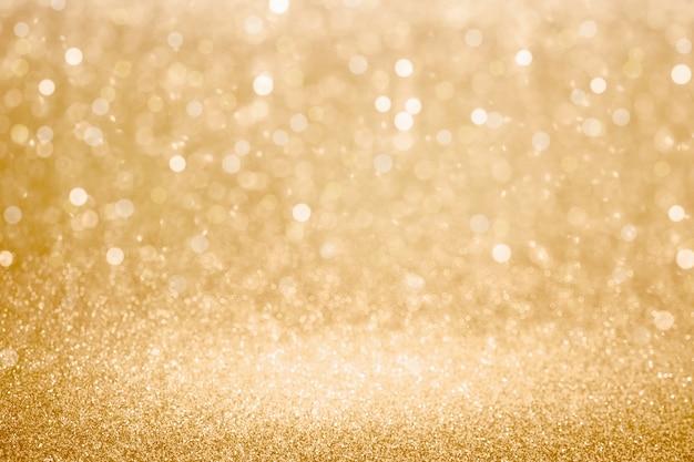 Goldglitter und bokeh beleuchtet hintergrund