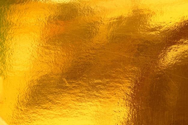 Goldhintergrund oder -beschaffenheit und farbverlaufsschatten