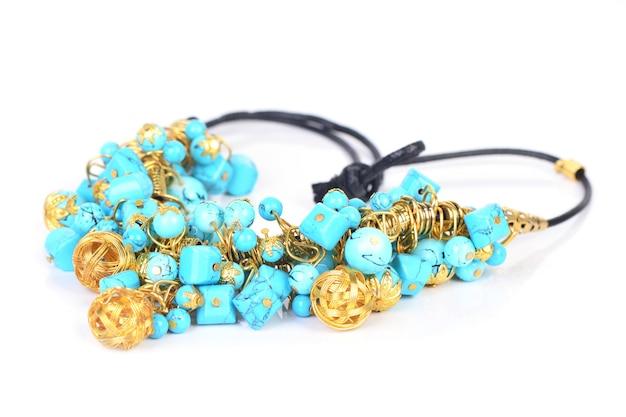 Goldkette mit türkis