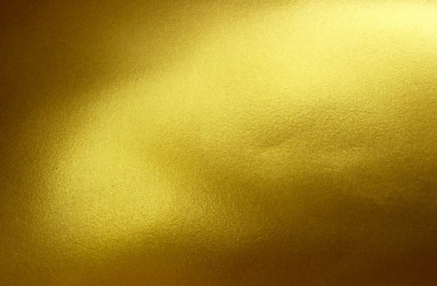Goldmetall gebürsteter hintergrund oder textur aus gebürstetem stahl