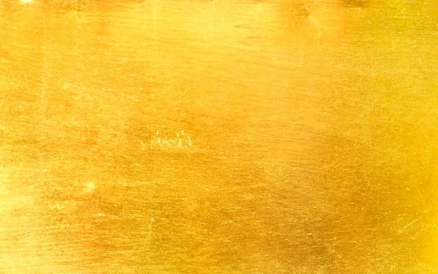 Goldmetall gebürsteter hintergrund