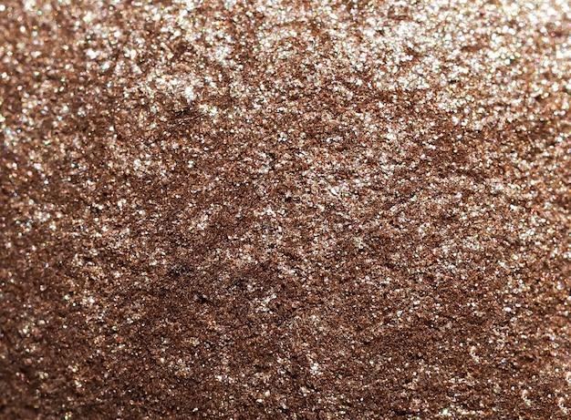 Goldpulverhintergrund, nahaufnahmetextur. abstrakter hintergrund der goldglitterbeschaffenheitbeschaffenheit.