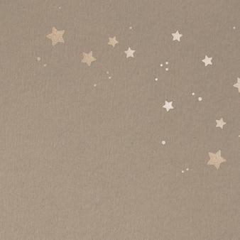Goldschimmernde sterne auf beigem hintergrund