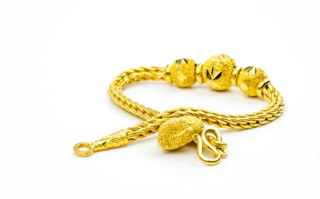 Goldschmuckarmband der thailändischen art lokalisiert auf weiß mit kopienraum