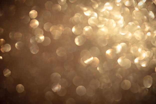 Goldunschärfe bokeh luxushintergrund