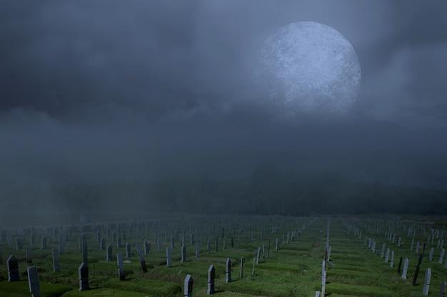 Grabsteine auf dem friedhof mit vollmondhintergrund. halloween-konzept