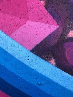 Graffiti-hintergrund abstrakte straßenkunst bunte und helle zeichnungslinien an der wand