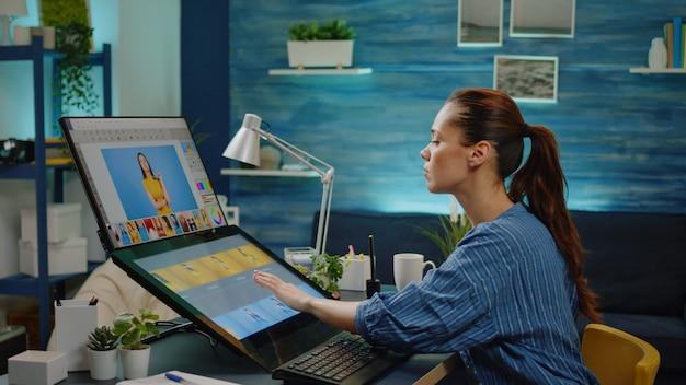 Grafikdesigner mit touchscreen für retuschearbeiten