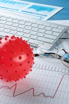 Grafiken und histogramme, virus. konzept des niedergangs der weltwirtschaft aufgrund des ausbruchs des coronavirus. sinkende finanzindikatoren und -einnahmen, der zusammenbruch von aktienkursen und wertpapieren.