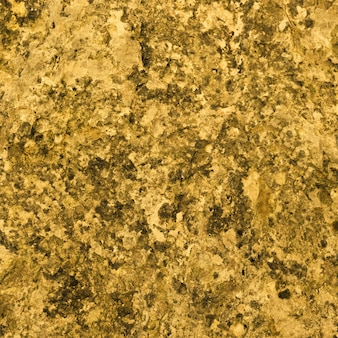 Granite textur, gelber, goldener granithintergrund, material für dekorative textur, innenarchitektur.