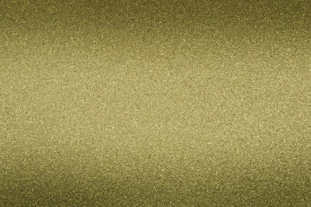 Granithintergrund-kakifarbige farbe mit kleinen punkten. verdunkelung von oben und unten.