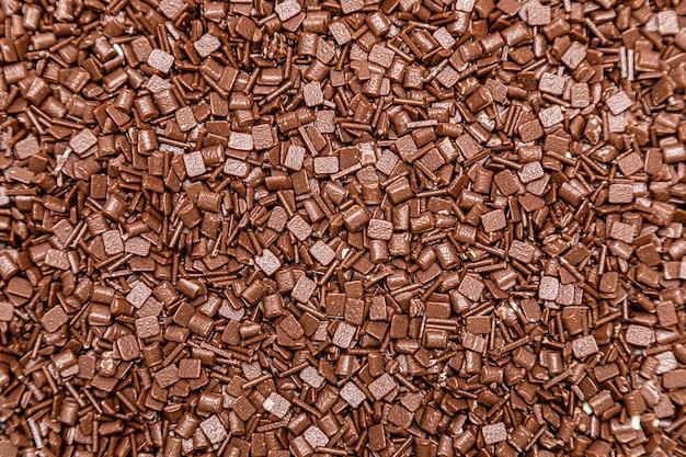 Granulierter milchschokoladenbeschaffenheitshintergrund