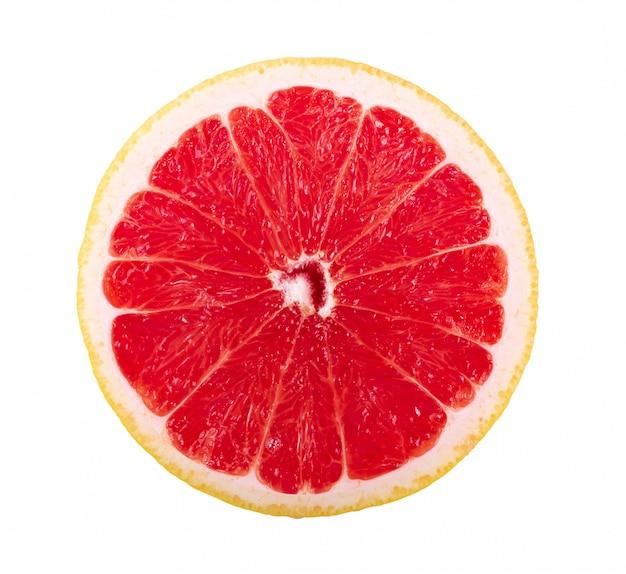 Grapefruitscheibe auf weißer wand